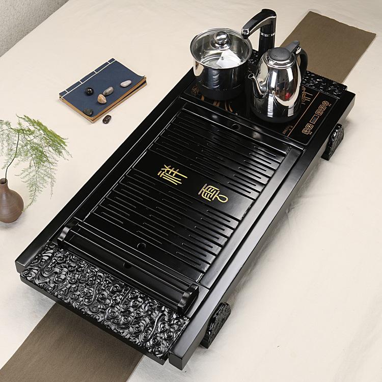 Bàn pha trà làm bằng gỗ tre, có kèm bếp cảm ứng và ấm đun Dehua