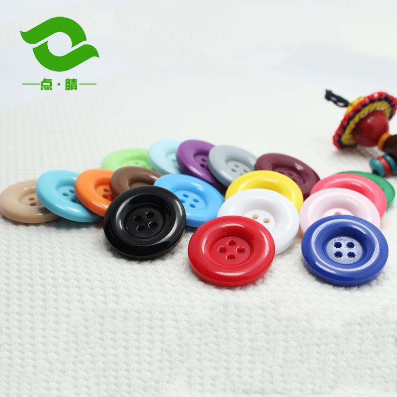 Phụ kiện bắt mắt Nút tròn bốn mắt Nút nhựa Phụ kiện quần áo nút áo khoác Nhà sản xuất