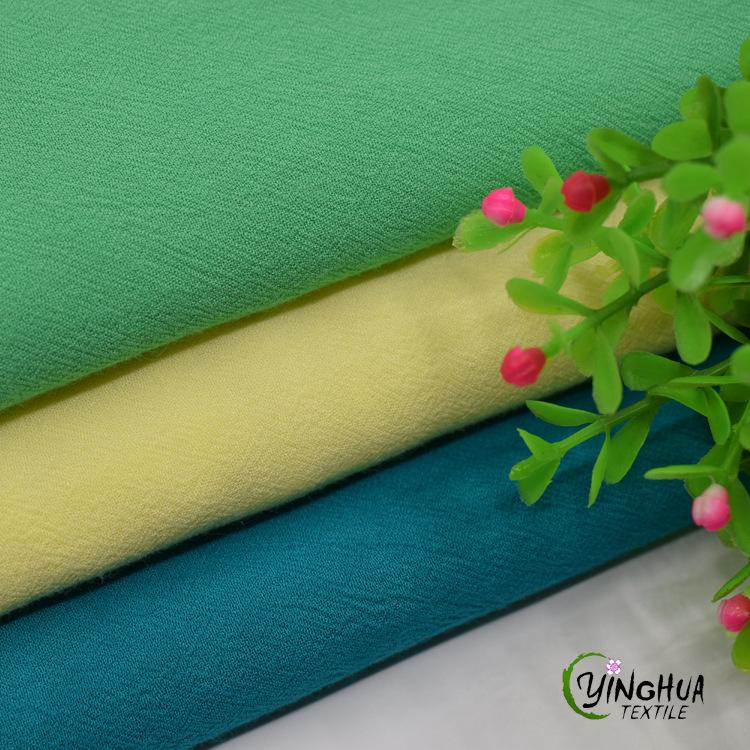 Nhà máy trực tiếp dệt bông dày đôi nhăn vải mùa xuân và mùa hè thời trang phụ nữ mặc vải rayon vải