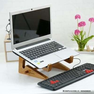 khung gỗ đỡ máy tính xách tay .