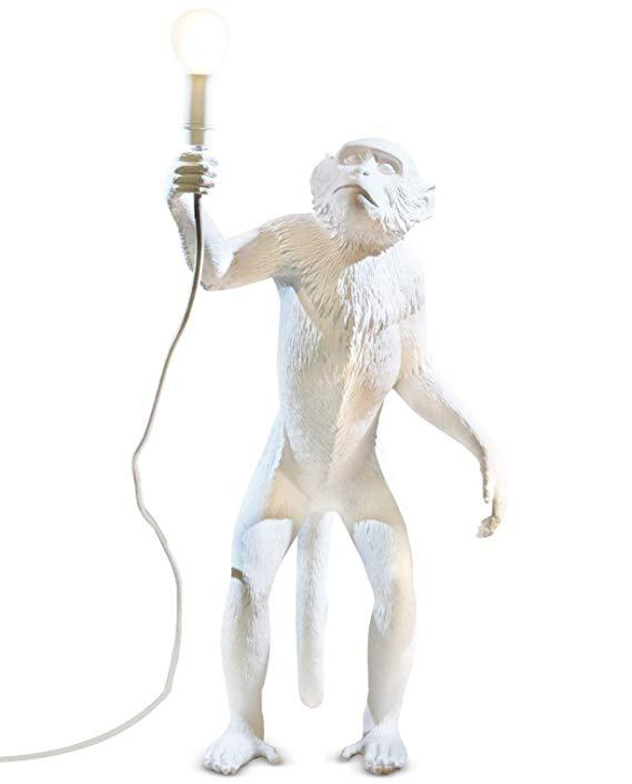 Mô hình Đồ trang trí tượng chú khỉ cầm đèn .