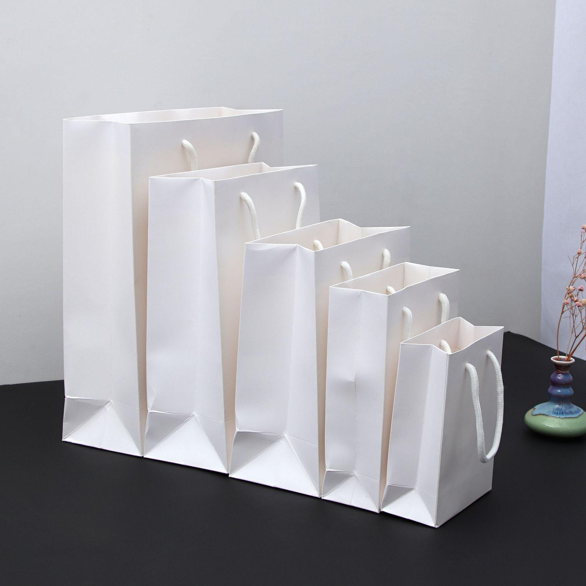 YIDAIKU NLSX bao bì 2019 túi bìa cứng màu trắng bao bì tote túi in tại chỗ quà tặng túi mua sắm tùy