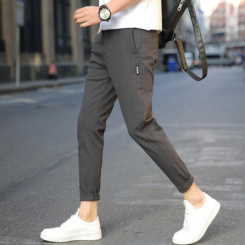 Quần Xu hướng mới 2018 quần âu thời trang hoang dã quần mùa thu nam chín quần trên chân rộng cotton