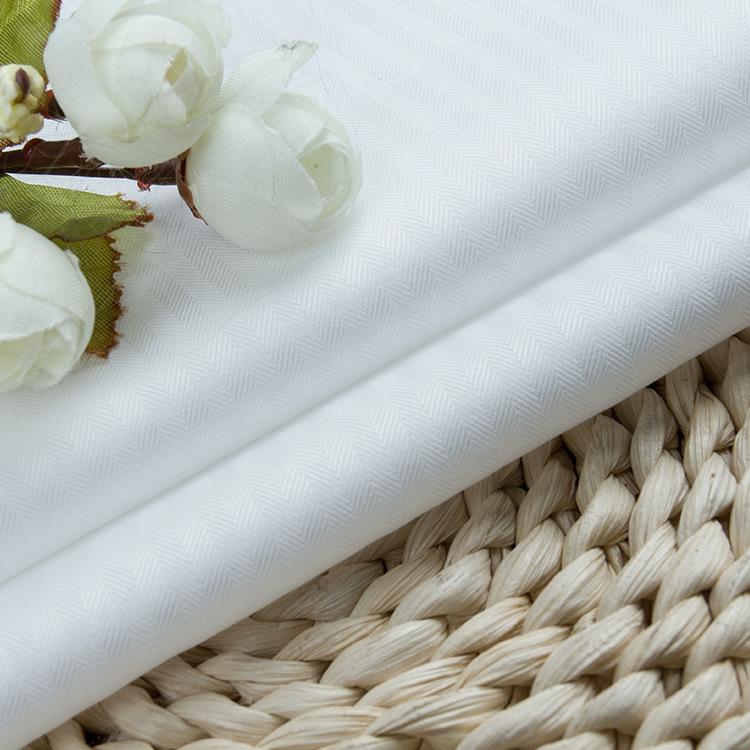 Vải cotton pha polyester Nhà máy trực tiếp bông dệt xương cá trắng xiên áo vải lỏng amoniac vải khôn