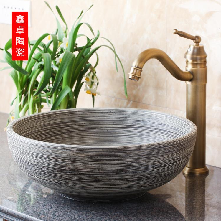 Nội Thất phòng Tắm : Bồn Rửa Mặt bằng Tấm gốm nghệ thuật  .