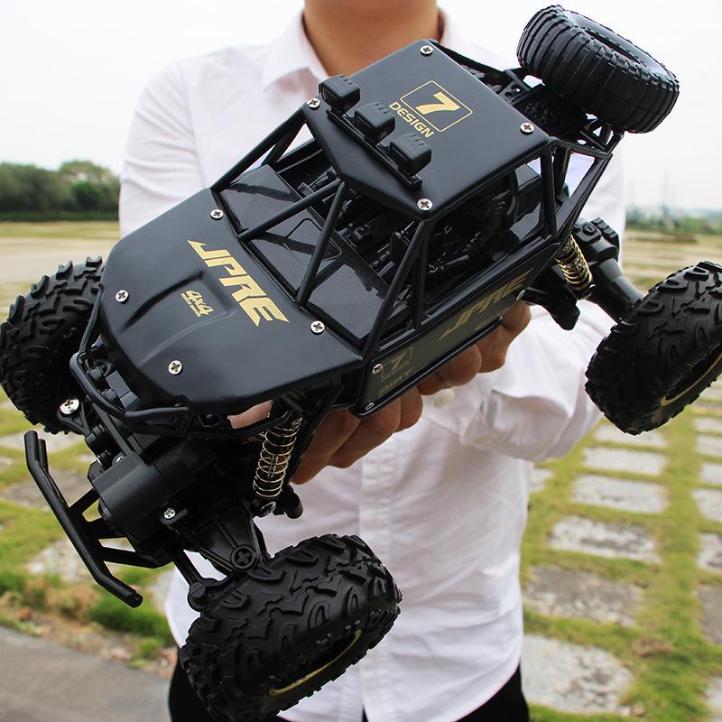 XYCQ Xe điều khiển từ xa Phiên bản quá khổ của hợp kim leo núi chân lớn lái xe bốn bánh điều khiển t