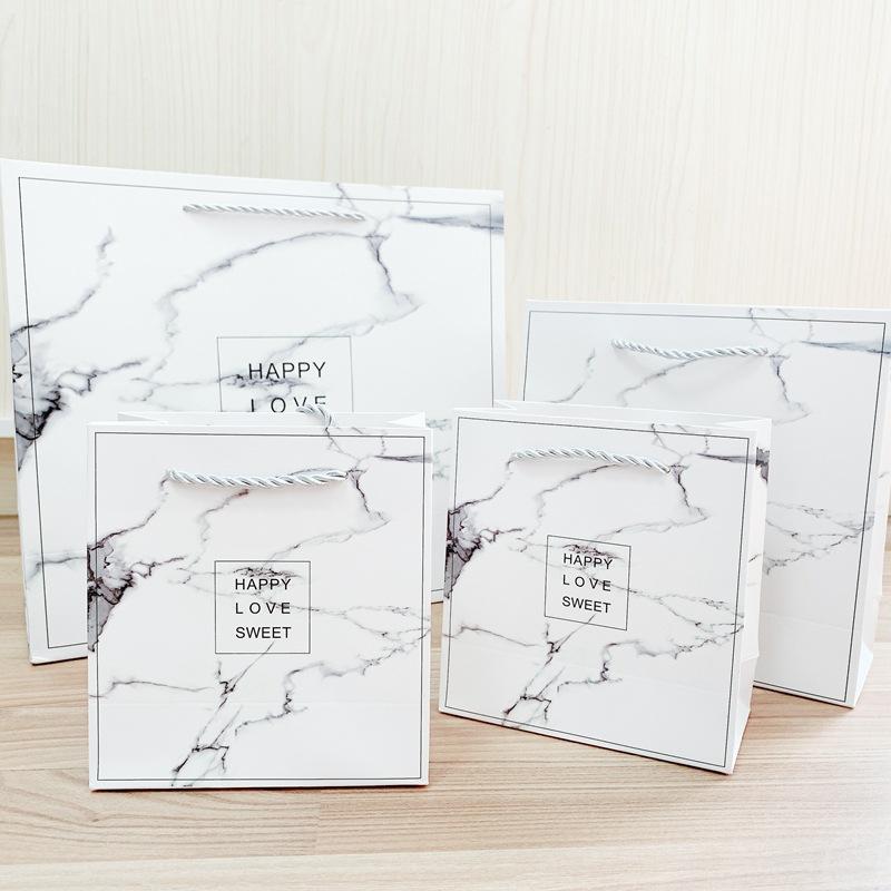 Túi giấy cẩm thạch tùy chỉnh Túi quà tặng di động phổ biến trong gió Túi quà tặng quần áo đơn giản i