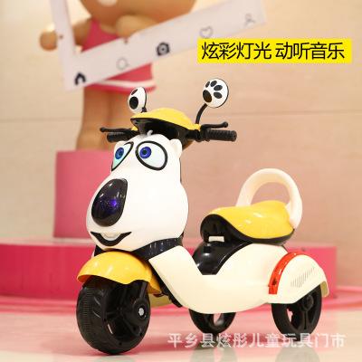 Xe điện trẻ em ba bánh hình chú chó .
