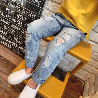 Quần trẻ em 2019 phiên bản Hàn Quốc mới của chàng trai và cô gái già lỗ hoang dã jeans quần jeans tr