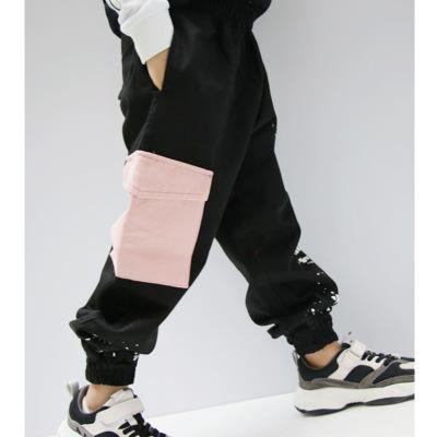 Quần trẻ em Quần áo trẻ em 2019 mùa thu và mùa đông thủy triều trẻ em quần túi quần giật gân in mực