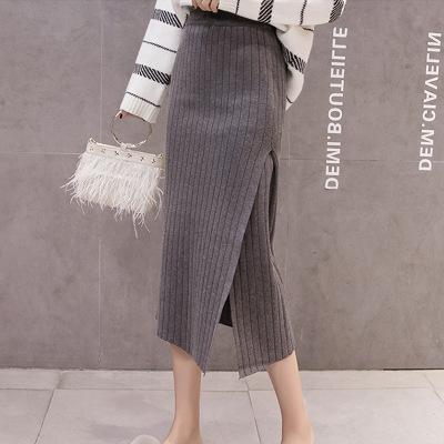 váy Mùa thu đông 2019 mới eo cao thon gọn thon gọn màu rắn hoang dã khí chất dài túi xẻ hông đan vá