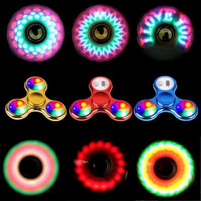 Đồ chơi phát sáng Nhựa UV con quay mạ với ánh sáng 18 thay đổi LED ánh sáng pha lê trẻ em quay ngón