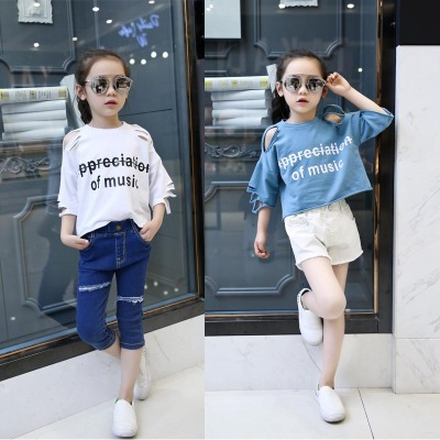 Áo thun trẻ em 2016 cô gái mùa hè phiên bản châu Âu của lỗ thủy triều rò rỉ vai áo thun cotton ngắn
