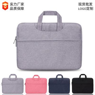 Túi xách đựng máy tính xách tay có thể đeo chéo .