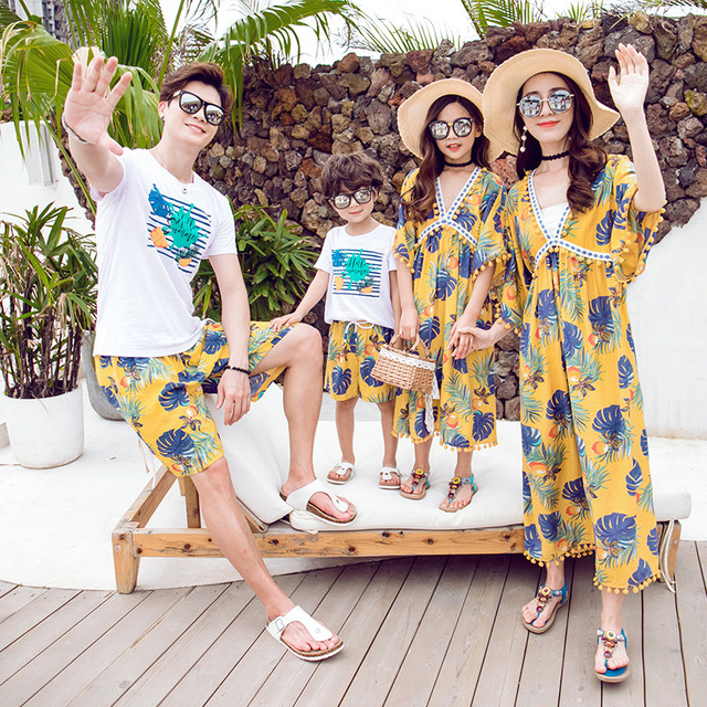 Áo thun gia đình Túi tóc giúp Cha mẹ mặc con và mẹ 2019 hè mới váy đi biển chất béo MM váy đi biển đ