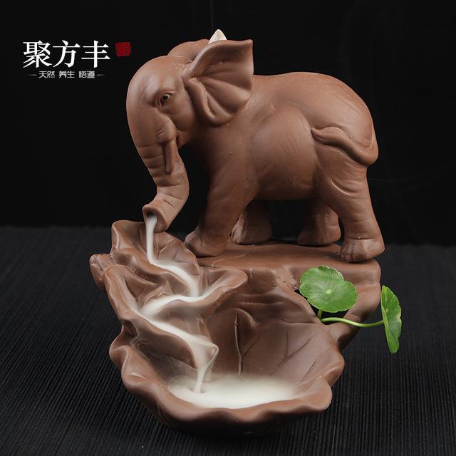 Tượng chú voi xông trầm hương bằng gốm .
