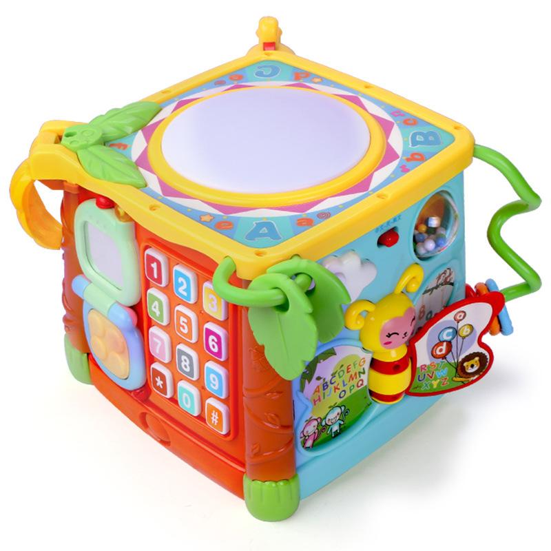 Gu Yu Đồ chơi hexahedron 3839 giáo dục mầm non câu đố âm nhạc pat baby baby hand trống baby toy 6-12