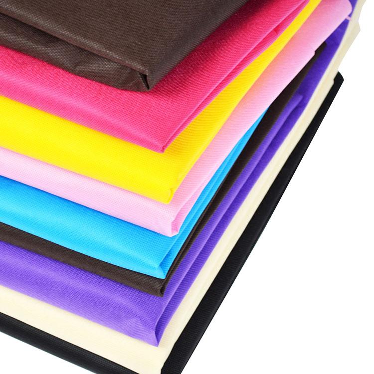 HUAHAO Vải không dệt PP màu không dệt spunbond cán nóng vật liệu mới sợi polypropylen nhà sản xuất v