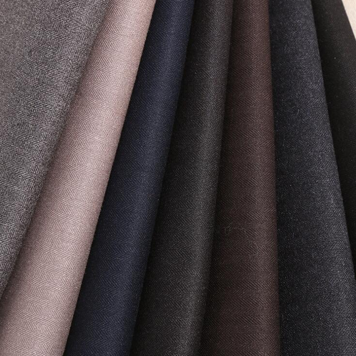 Vải pha sợi TR plain twill fabric stock fall and winter high-end men's suit fabric with a cloth fro