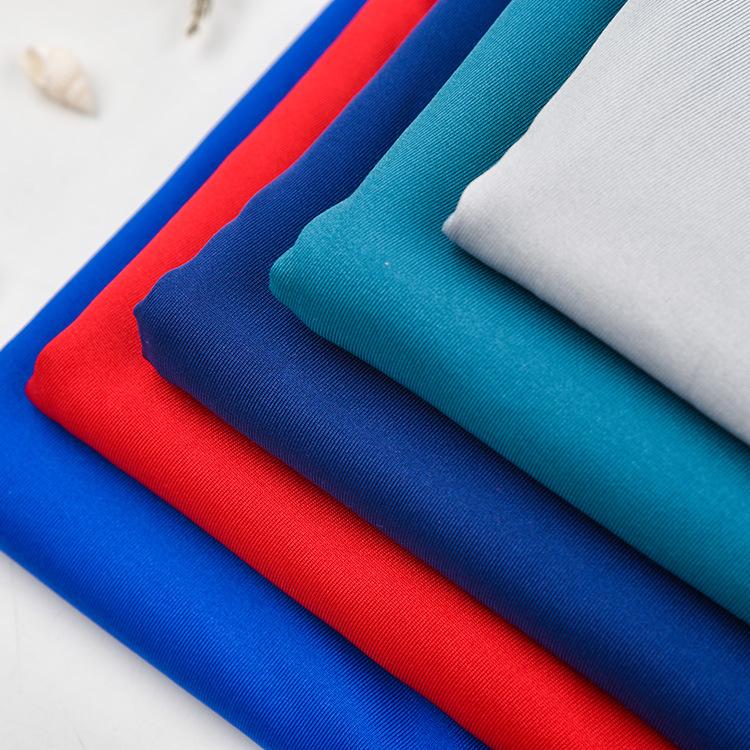 Vải dệt kim Vải lụa sữa mới Vải dệt kim bốn mặt co giãn Quần áo thể dục Yoga Quần áo bơi nhà sản xuấ