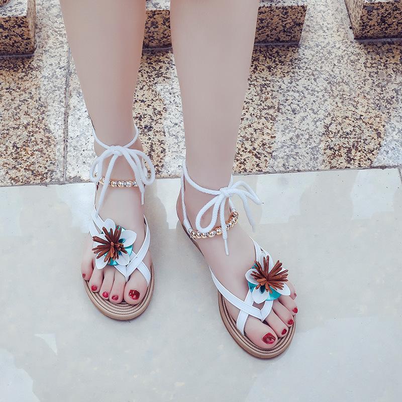 Giày sandal đế xẹp quai ngang dành cho nữ .