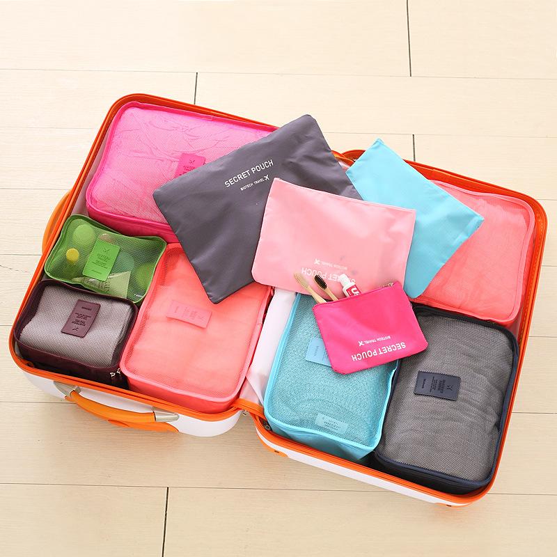 Túi lưu trữ du lịch gồm sáu bộ hành lý quần áo
