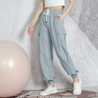 Quần áo mau khô Quần thể thao kích thước lớn mới quần phụ nữ rộng rãi quần áo yoga phụ nữ bỏ túi chí