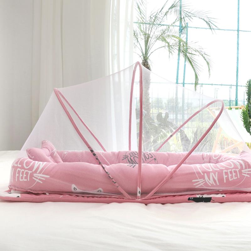 Giường cotton di động có thể tháo rời và có thể giặt cho bé .