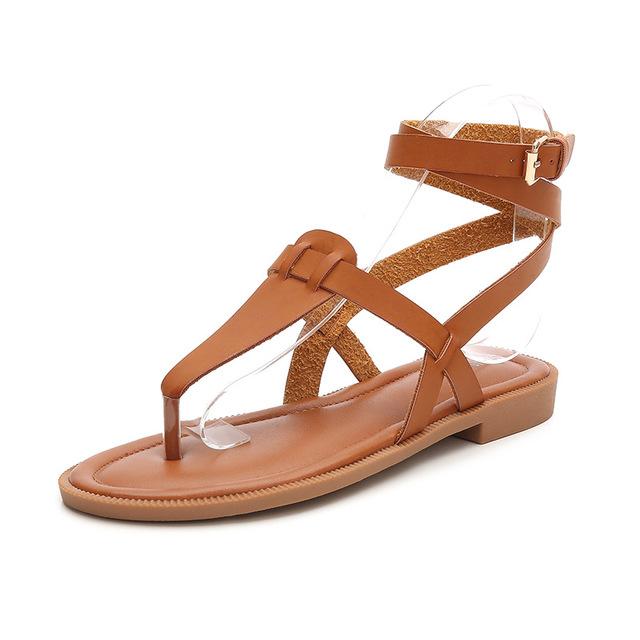 Giày sandal dây đế bằng dành cho nữ .