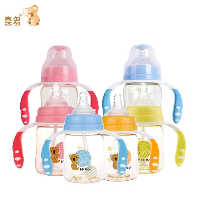 Bình sữa có tay cầm chống rơi dành cho bé .