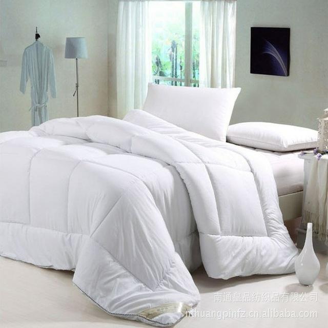 Mền sợi tổng hợp Màu sắc tinh khiết chăn mùa đông bán buôn sữa dưỡng ẩm sợi hóa chất khách sạn đặc b