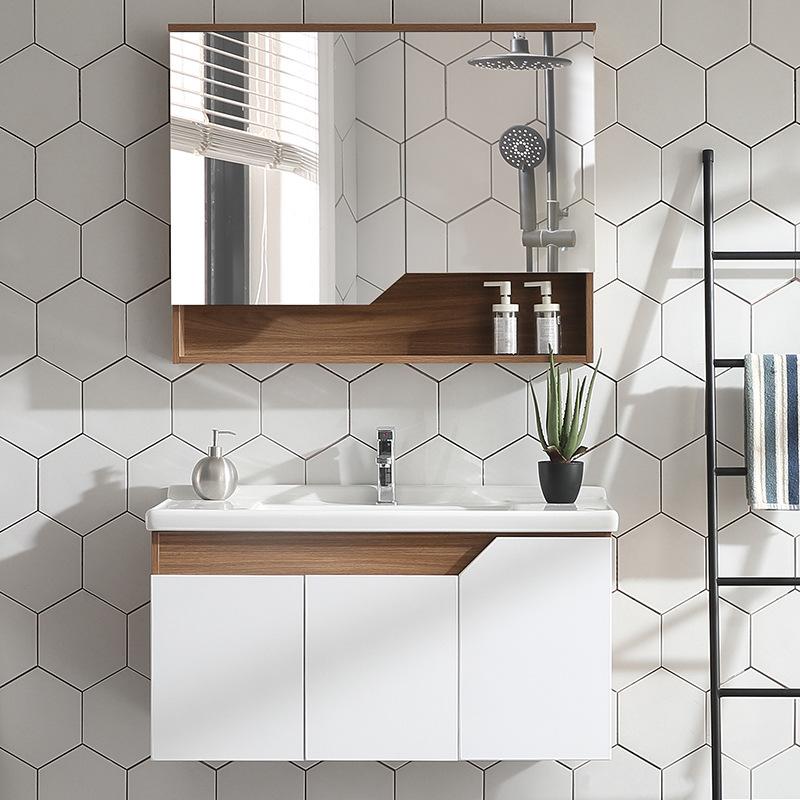 Phòng tắm tối giản hiện đại kết hợp tủ vệ sinh vanity chậu rửa và tủ lưu trữ lớn.