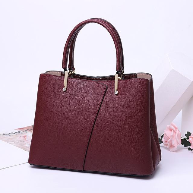 Túi xách da kiểu dáng thời trang trung niên cho phụ nữ .