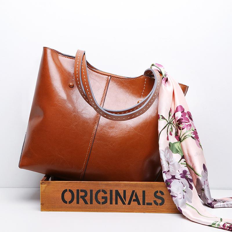 Túi xách da đeo vai size bự kiểu dáng thời trang cho nữ .