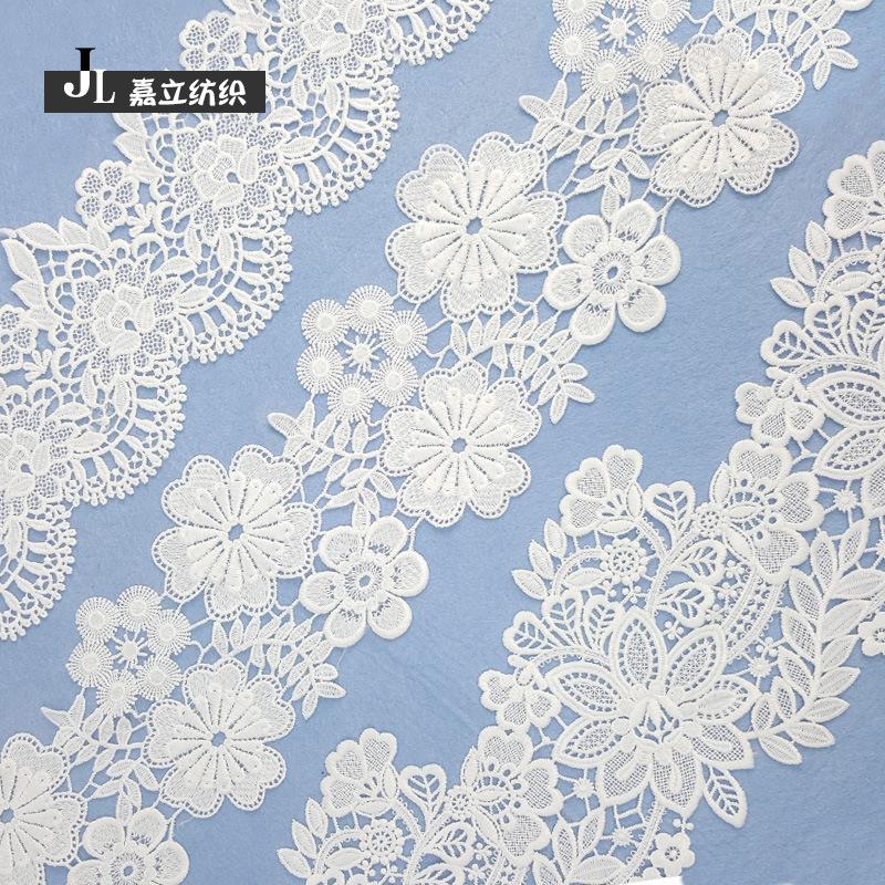 JIALI ren viền Nhà máy Spot Hollow Sữa Silk tan trong nước Ren thêu Hoa trắng mới Không căng Mã vạch