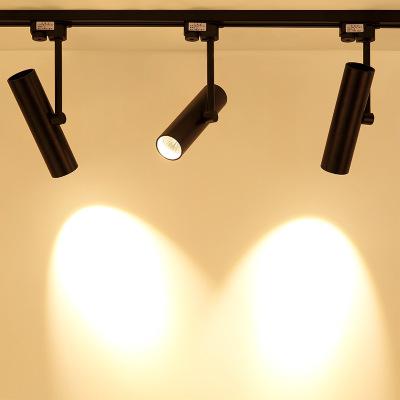 Đèn LED gắn ray Bề mặt Bắc Âu gắn đèn chiếu sáng led trần ánh sáng trần nhà phòng khách TV nền tường