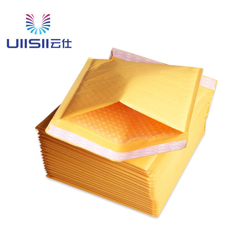 Túi phong bì giấy kraft lót bong bóng bên trong màu vàng .