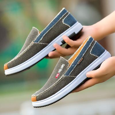 Giày lười bằng vải thoáng khí kiểu dáng thể thao năng động .