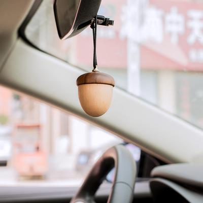 Dây chuyền tỏa hương thơm hình hạt dẻ bằng gỗ dùng trang trí xe hơi .