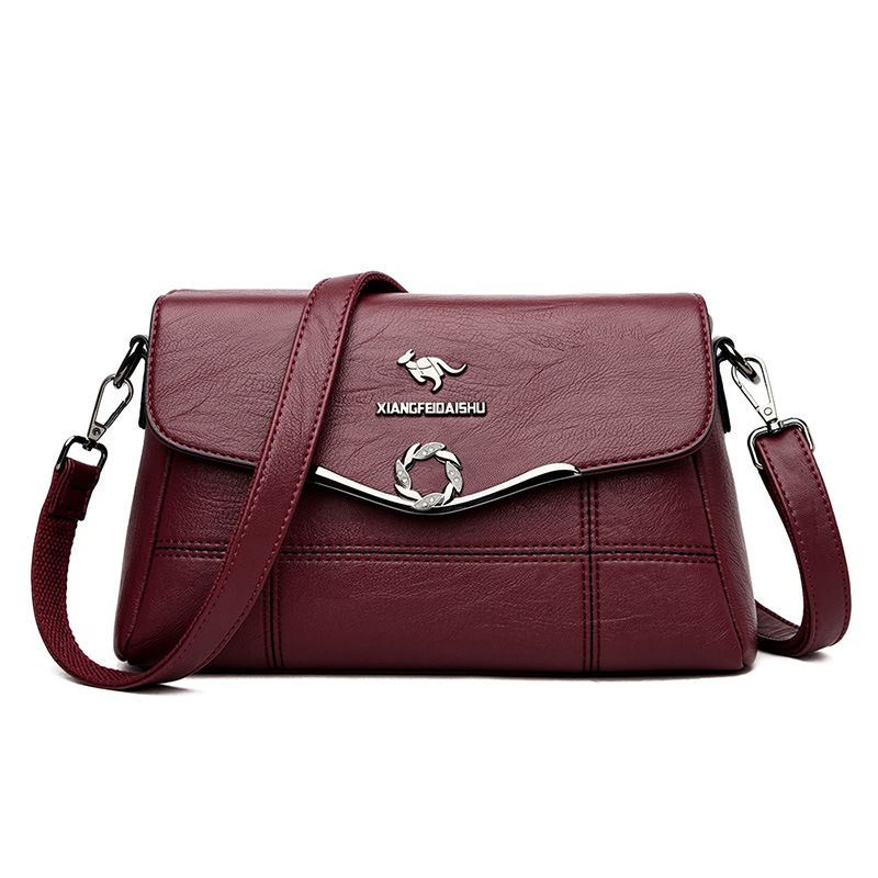 Túi xách nữ kiểu dáng thời trang giản dị da mềm dành cho trung niên .