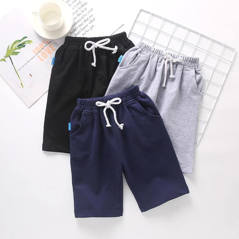 SNBB Quần trẻ em Quần bé trai mùa hè váy nữ mới màu xanh đậm đồng phục học sinh quần lớn bé trai mỏn