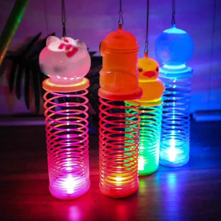 Đồ chơi phát sáng lò xo đèn lồng di động cho bé .