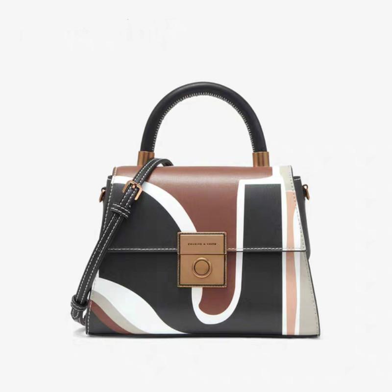 Túi xách nữ phối màu phong cách thanh lịch .
