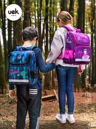 uek Cặp học sinh Hot  túi đi học tiểu học nam và nữ 1-3-5 học sinh lớp một nam 3-12 tuổi ba lô nhẹ