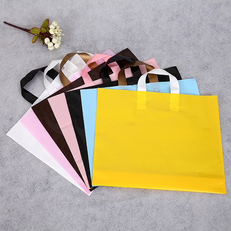 Men, women and children clothing store bags custom LOGO portable PE plastic bags gift shopping bags