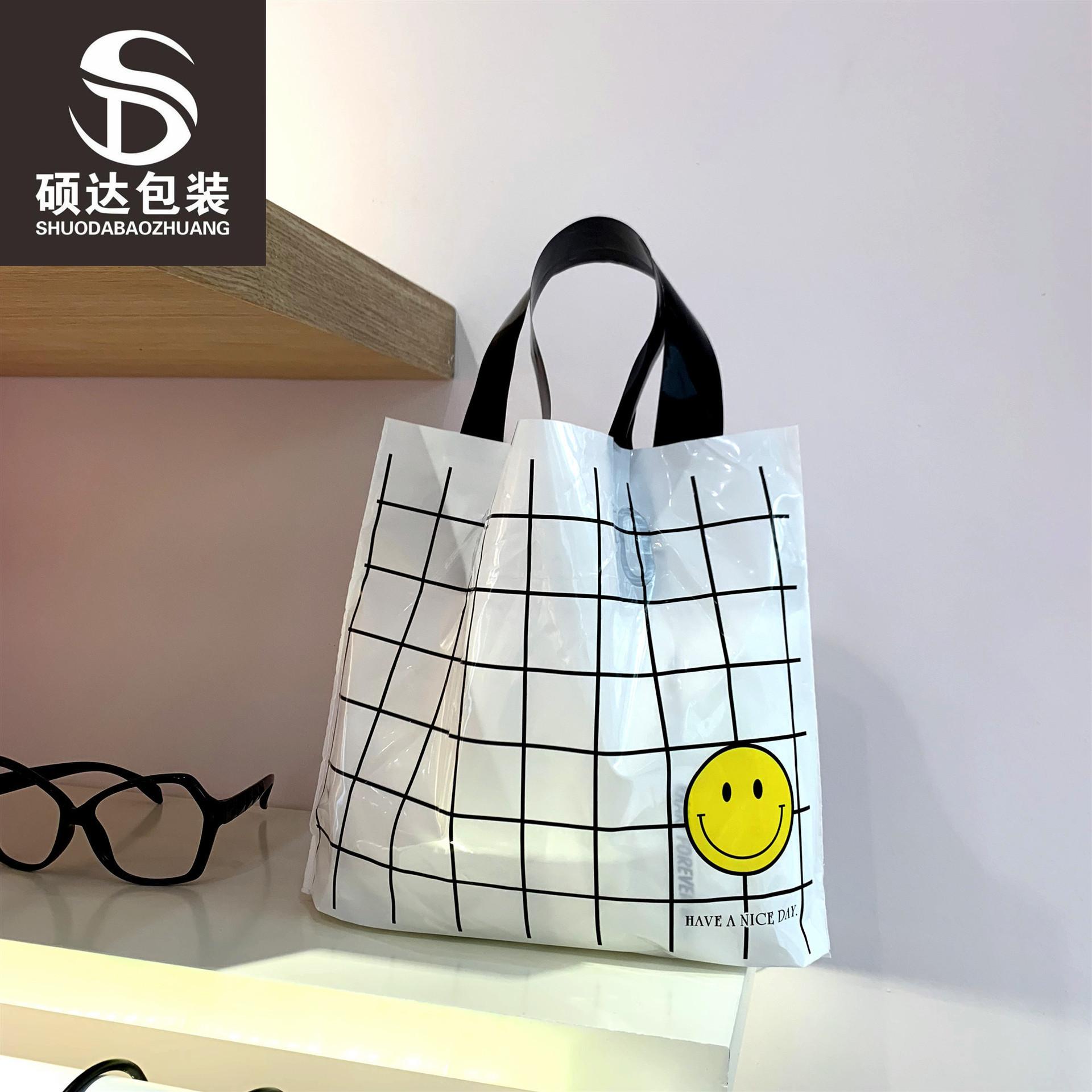 Ins clothing portable check smiley face Korean milk white men and women Plaid plastic hand bag carto