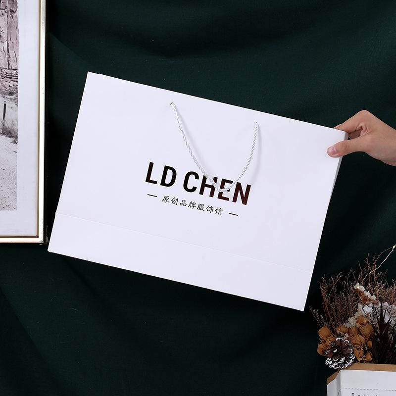 Clothing paper bag customized shopping bag handbag customized clothing store high grade gift bag pri