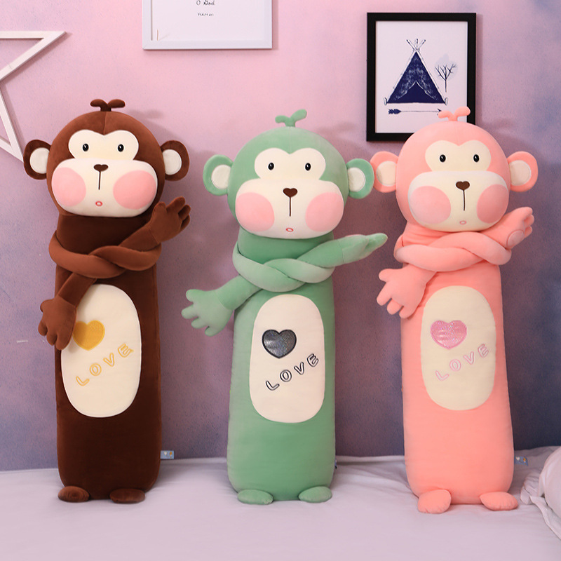 Cute and cute monkey plush toy doll on the bed holding a pillow that accompanies you to sleep, a gir