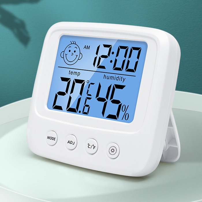 E0828 new smiling face hygrometer with hanging hole can be hung on the wall