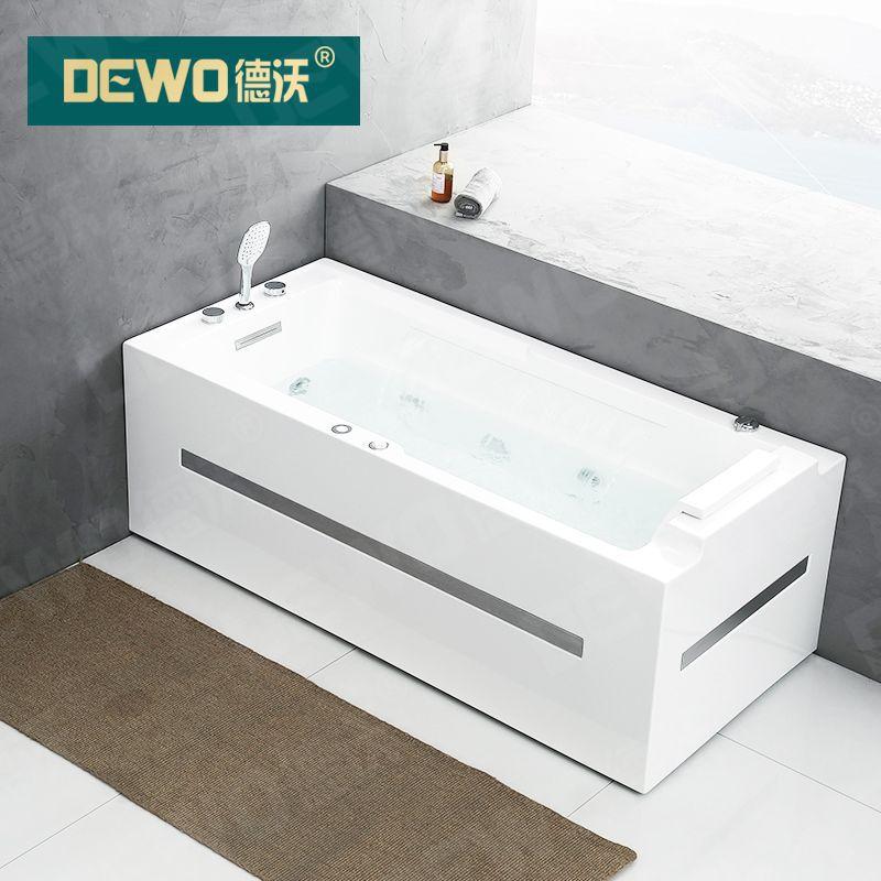 Bồn tắm liền mạch acrylic kiểu dáng đơn giản .